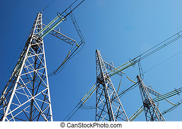 Electricity pylons on the sky background