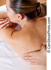young woman back massage - young woman receiving back...