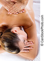 back massage - young woman receiving back massage