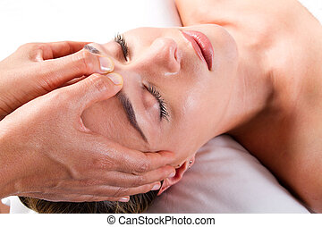 head massage in beauty salon - pretty young woman receiving...
