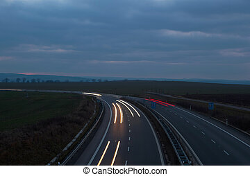 Cars moving fast on a night highway
