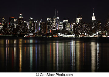 Midtown West Side Manhattan at night seen from Weehawken, NJ...