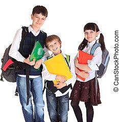 Schoolchildren with books - Three young schoolchildren of...