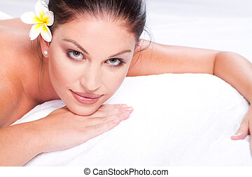 woman in spa salon - beautiful young woman face closeup in...