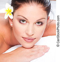 woman face closeup in spa - beautiful young woman face...