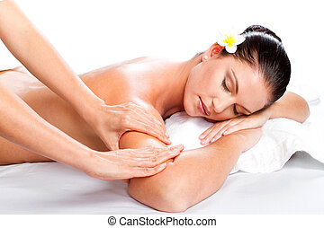 woman receiving massage - young beautiful woman receiving...