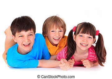 Smiling children - Smiling brothers and sister lying on...