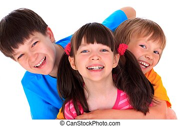 Happy children - Studio portrait of three smiling children,...