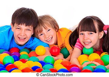 Children and colorful balls - A portrait of cute children...
