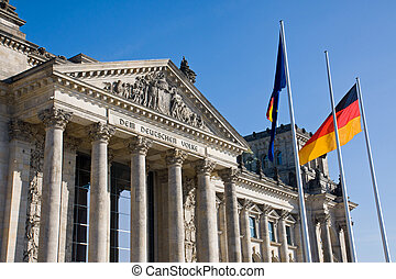 Reichstag with german flag - The Reichstag in Berlin with...