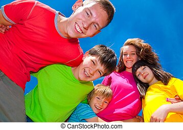 Children in colorful clothes - A group of happy laughing...