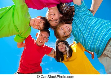 Smiling children - Smiling children wearing bright colored...