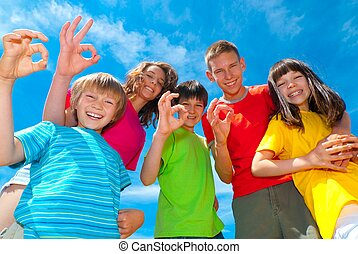 Smiling children's okay signs - Group of five happy children...