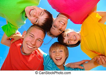 Happy Siblings - Smiling children wearing bright colored...