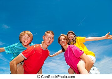 Happy Siblings - A group of happy laughing children wearing...