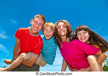 Happy Siblings - A portrait of happy siblings on the...