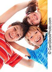 Three Happy Children - Three smiling happy children with...