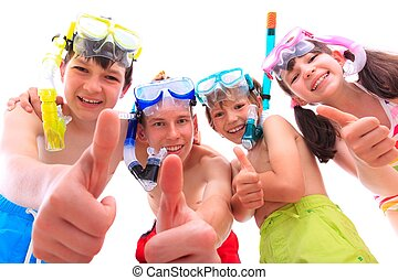 Happy children in snorkels - Closeup of three smiling...