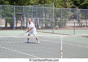 Senior Woman Plays Tennis