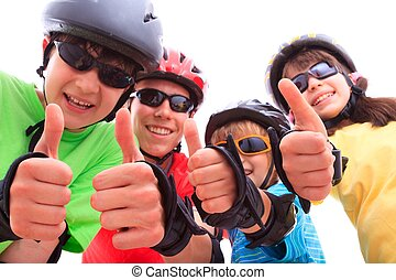 Kids giving thumbs up - Happy kids wearing sunglasses and...