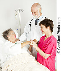 Attentive Hospital Staff - Attentive doctor and nurse caring...