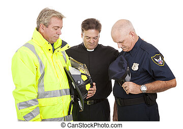 Praying at Work - Minister prays with a firefighter and...