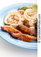 Fried Sweet Plaintains - Plate of Cuban food, with fried...