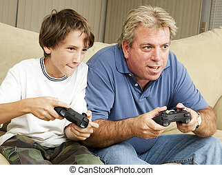 Video Gamers - Uncle and nephew (or father and son) playing...