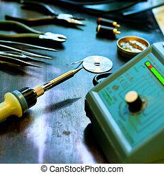 Soldering background - Soldering station with soft solder...