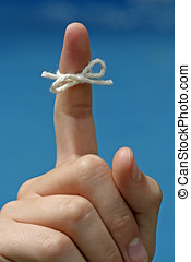 Dont Forget - A string tied around a finger to remind...