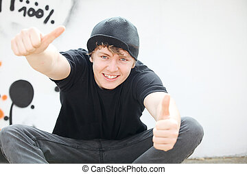 happy teen with thumbs up for success
