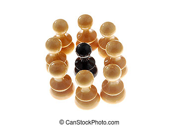 racism - black chess figure surrounded with white ones,...