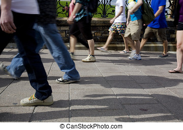 People Walking on the Sidewalk - A group of people walking...