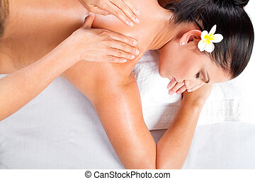young woman receiving back massage - overhead view of young...