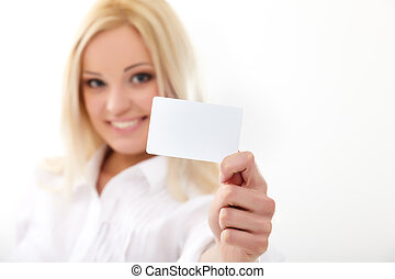 Credit card - Happy blond woman showing blank credit card...