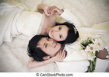 portrait of the newlyweds on studio shooting
