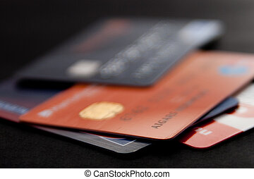 stack of credit cards on a black background