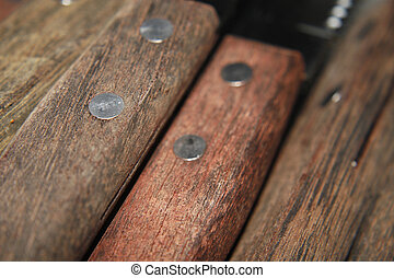 steak knife handles - close up image of brown steak knife...