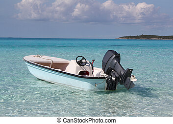 Small boat in the Caribbean - A small outboard motorboat...