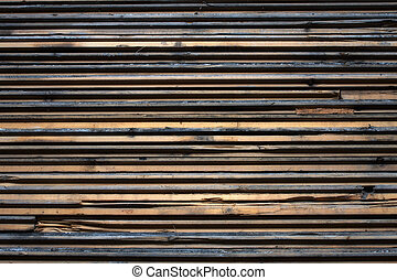 Slats of wood stacked with a rough texture