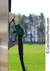 Pump nozzle - Side of one gas pump nozzles on a petrol...