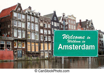 Welcome to Amsterdam sign in water