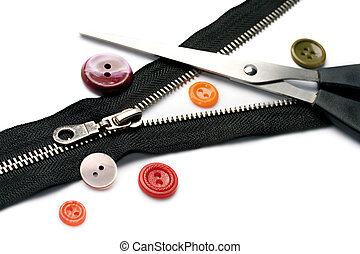 Scissors, zipper and button isolated on white