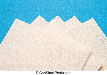Napkins isolated on blue background