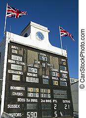 Cricket scoreboard - Traditional scoreboard in early evening...