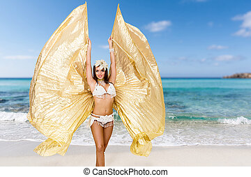 Belly dancer on the beach - Belly dancer Attractive woman...