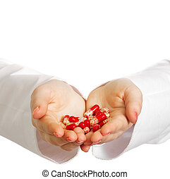 Female doctor holding many pills in her hands