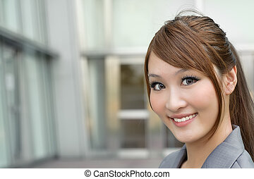 Young business manager woman smiling and looking at you,...