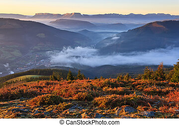 Mountains over the fog in the winter sunrise, Bizkaia, Spain