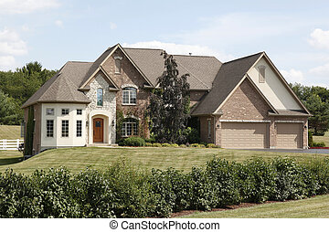 Luxury home with three car garage - Luxury home with arched...
